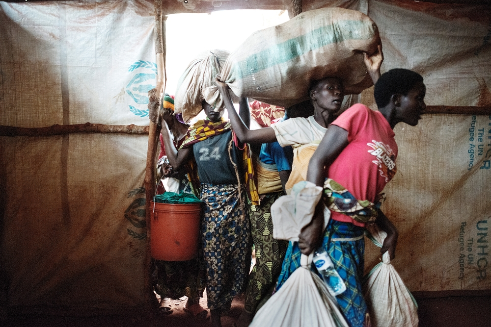 Newly arrived Burundian refugees enter the tent where they will stay in Nyarugusu, Tanzania.