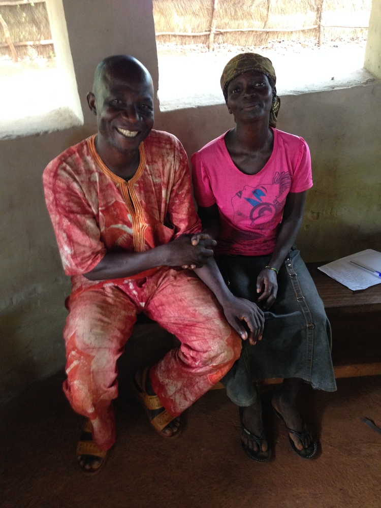Gisèle (right) sits beside MSF counselor, Joseph Mbolingbagbe.