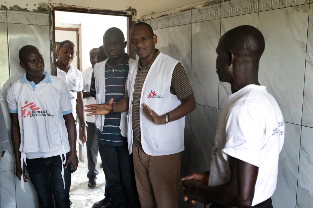 Dr. Ibrahim Diallo, MSF head of mission in Guinea, visits health posts in Cissella in March to prepare in for malaria season.