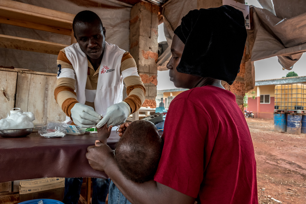 An MSF health worker tends to a young patient at an MSF project in Bangassou.