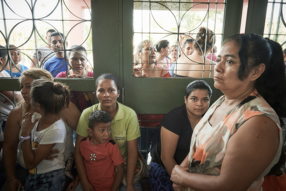 Women and children wait to be seen at an MSF clinic in Choloma.