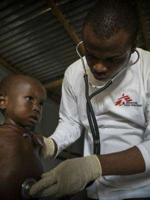 MSF nurse Deogracias Kabila examines a child with malnutrition in Bokoro.