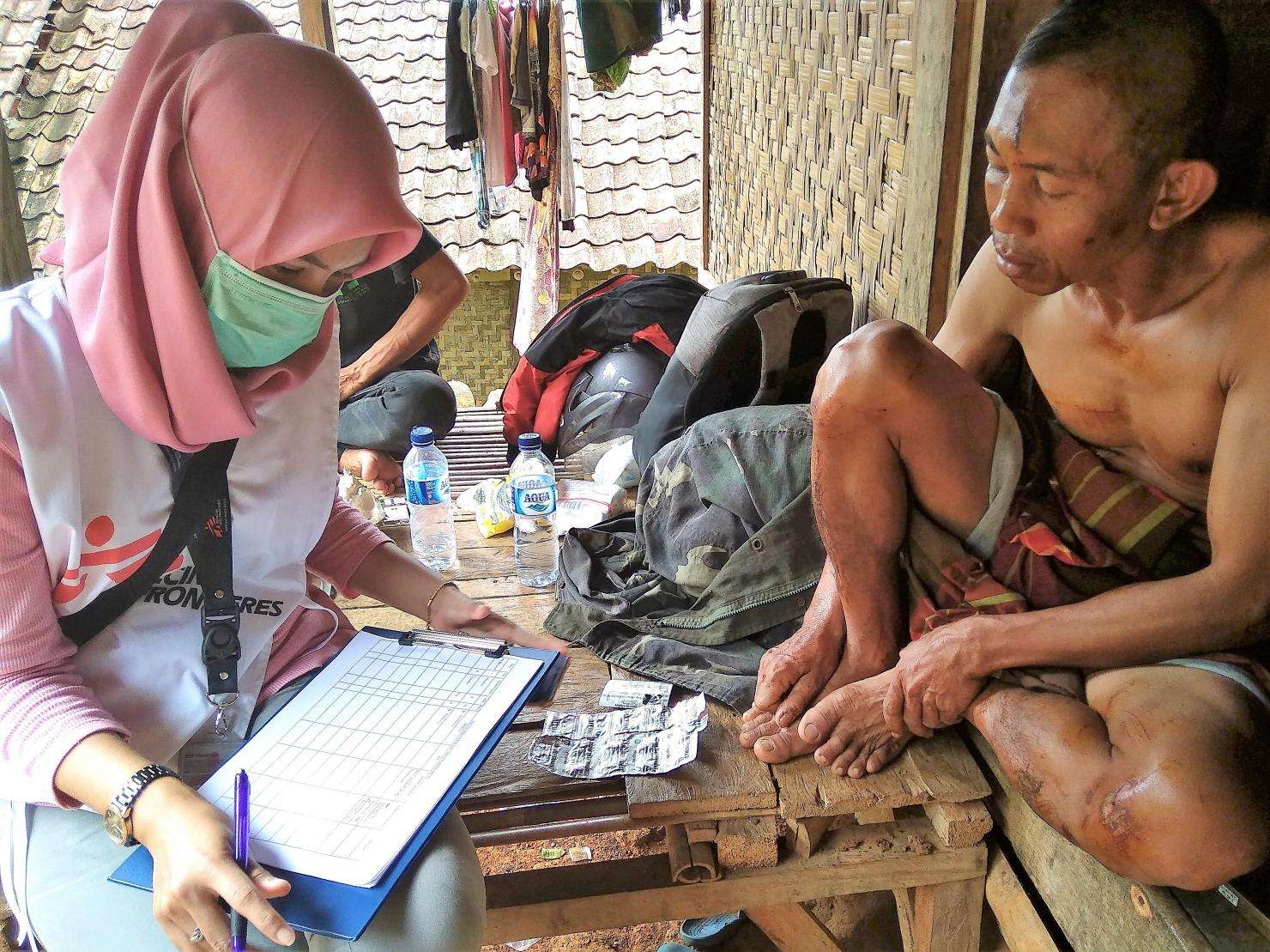 Dina Afiryanti, an MSF midwife, is interviewing one of the community members of Carita Sub district, in Pandeglang.