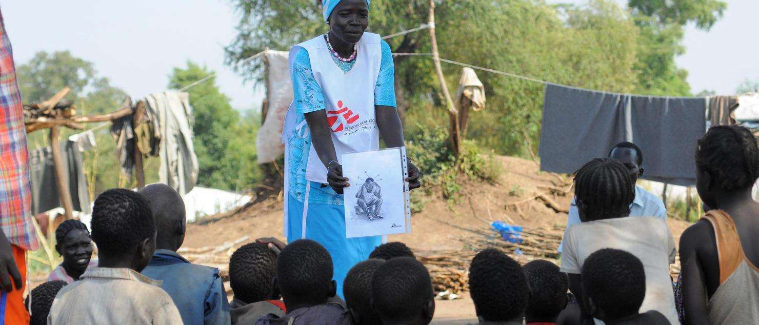 MSF team raising awareness about mental health issues in a refugee camp