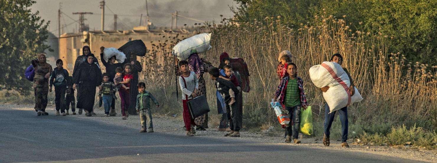 Civilians fleeing offensive in Ras al-Ain, Syria