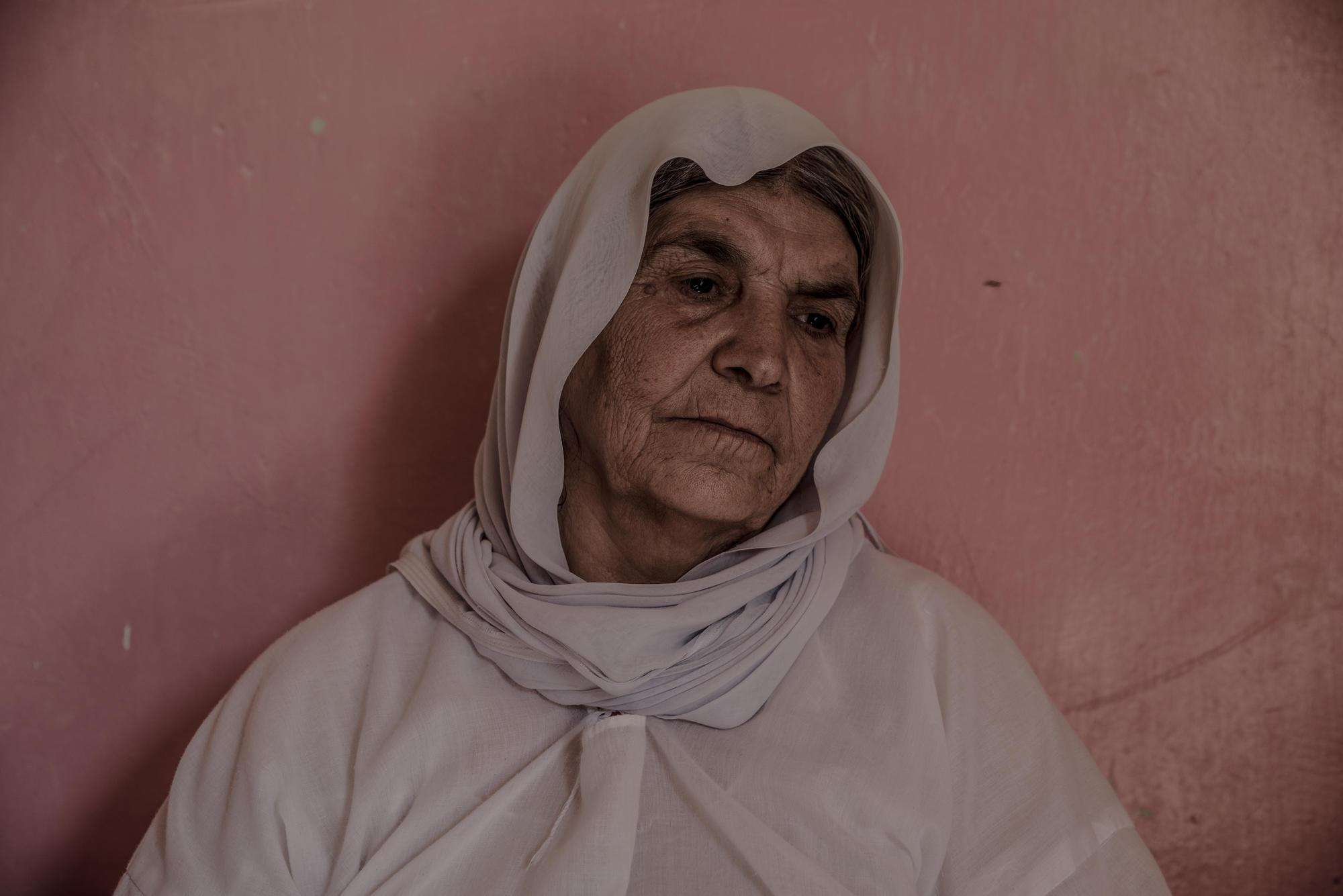 Halo Khalaf, 66, poses in her house in Sinuni on September 2nd, 2019.