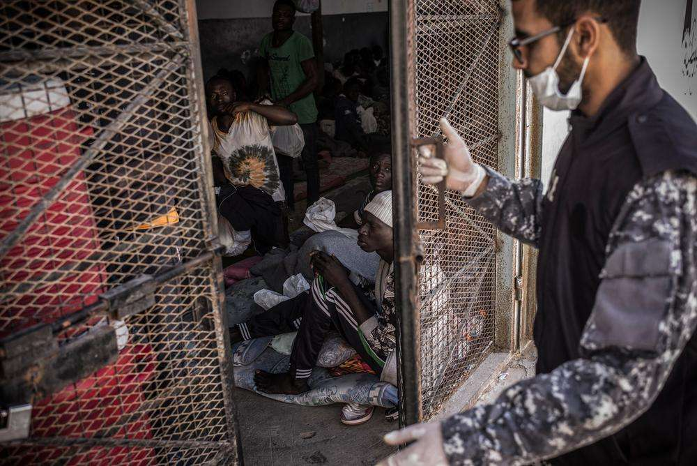 A guard is closing the door of a cell in Abu Salim detention center, in Tripoli, Libya.