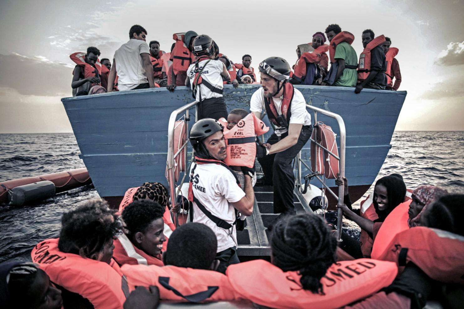 Teams from MSF and SOS Mediteranee help refugees and migrants.