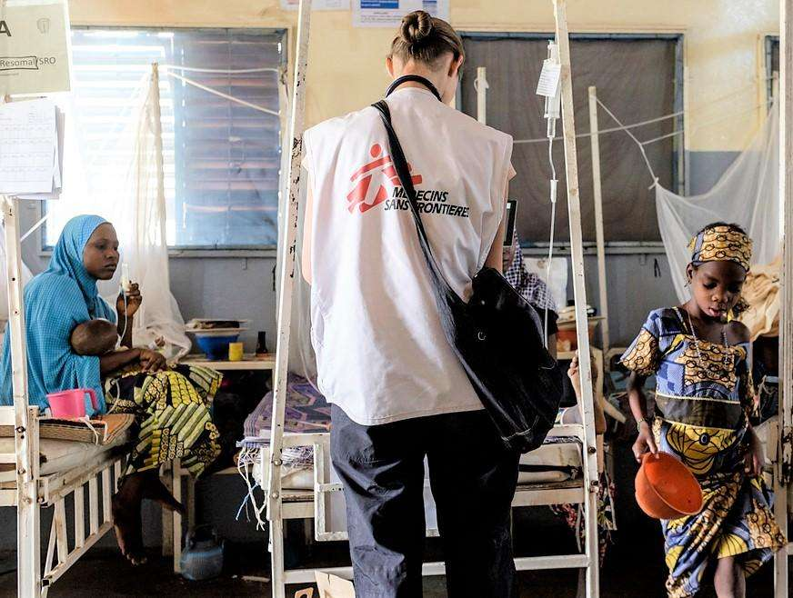 Inside Magaria hospital's paediatric unit. Early in the morning, MSF paediatrician Julia Rappenecker accompanied by the centre's medical personnel check on the children who have been admitted to the intensive care unit in the last 24 hours.