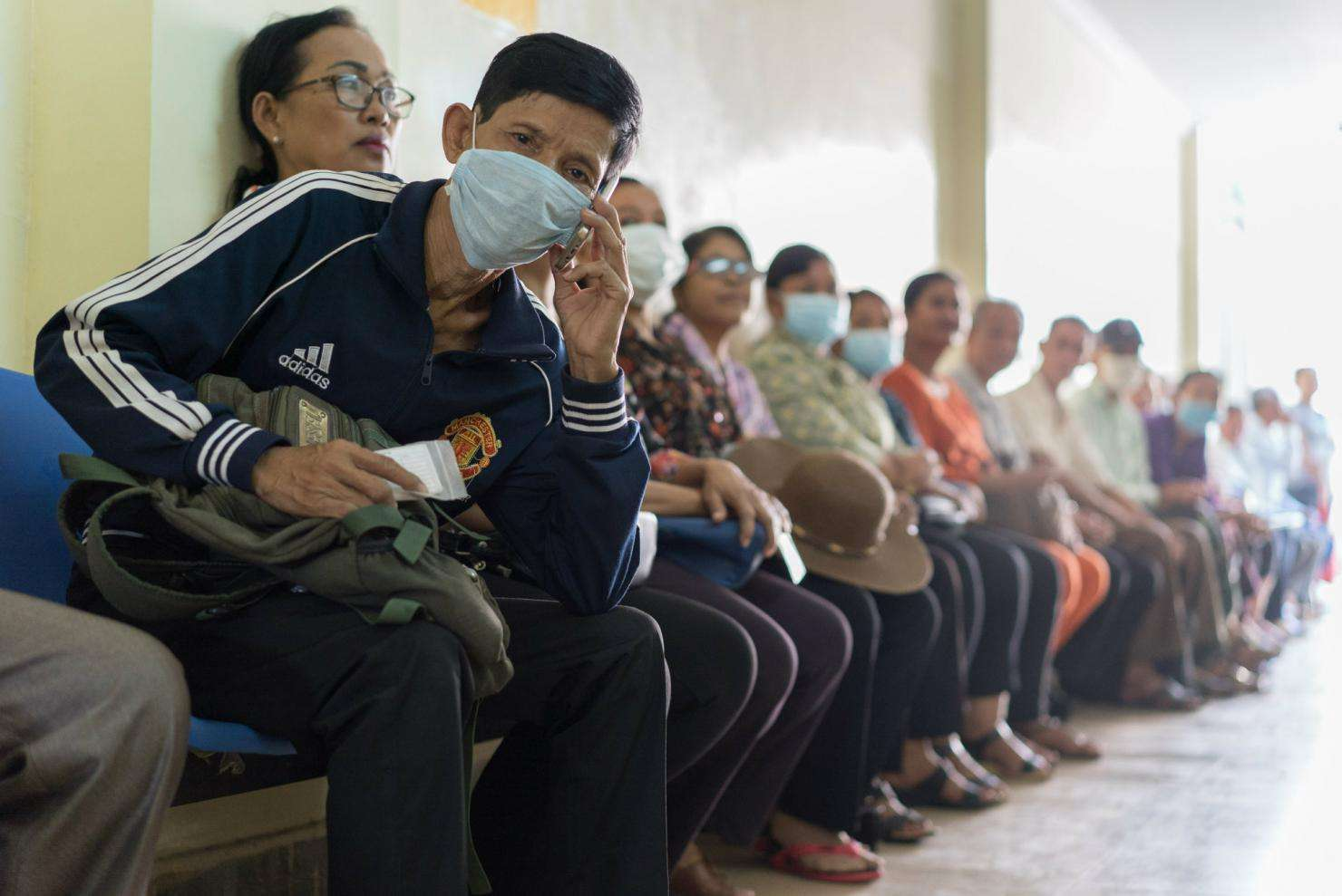 Patients wait for their appointment at the MSF Hepatitis C clinic in Phnom Penh, Cambodia.