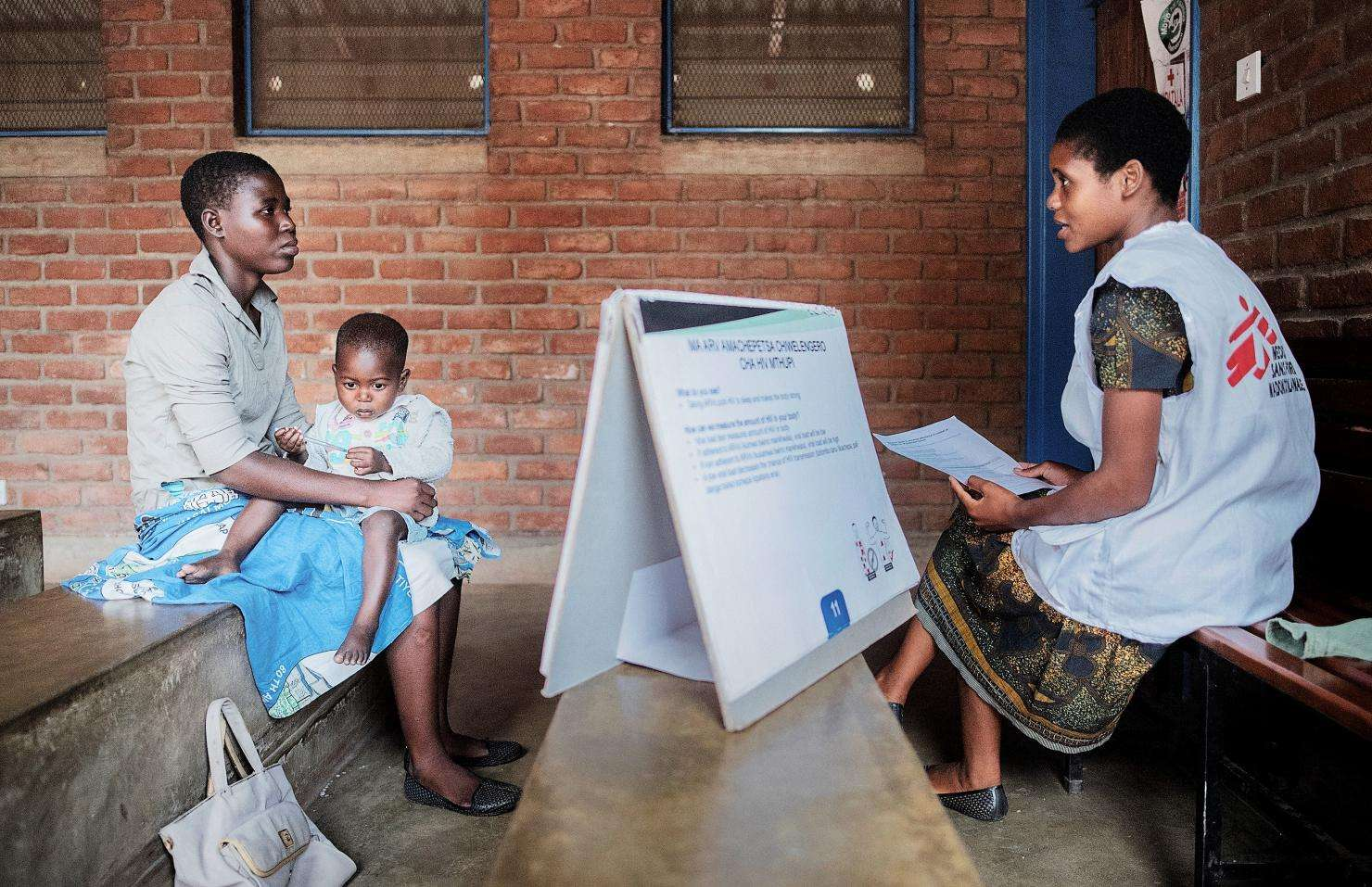 Mary Dyson (left) 23 years, from Nyambiro, sits in counseling room with her son, Harlod Dyson, 23 months old as she takes part in Enhanced Adherence Counseling (EAC) by MSF lay counselor Ruth Chumbu, 27 years in Sorgin Health Center, Nsanje health district.