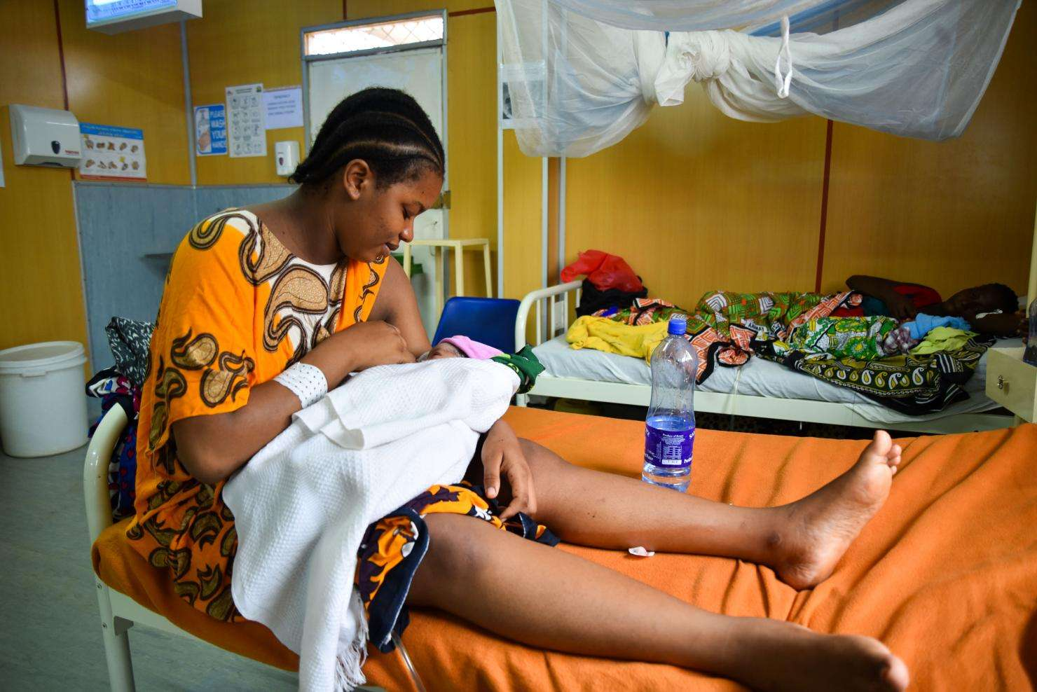 A mother and her child recover after a complicated Caesarean section.
