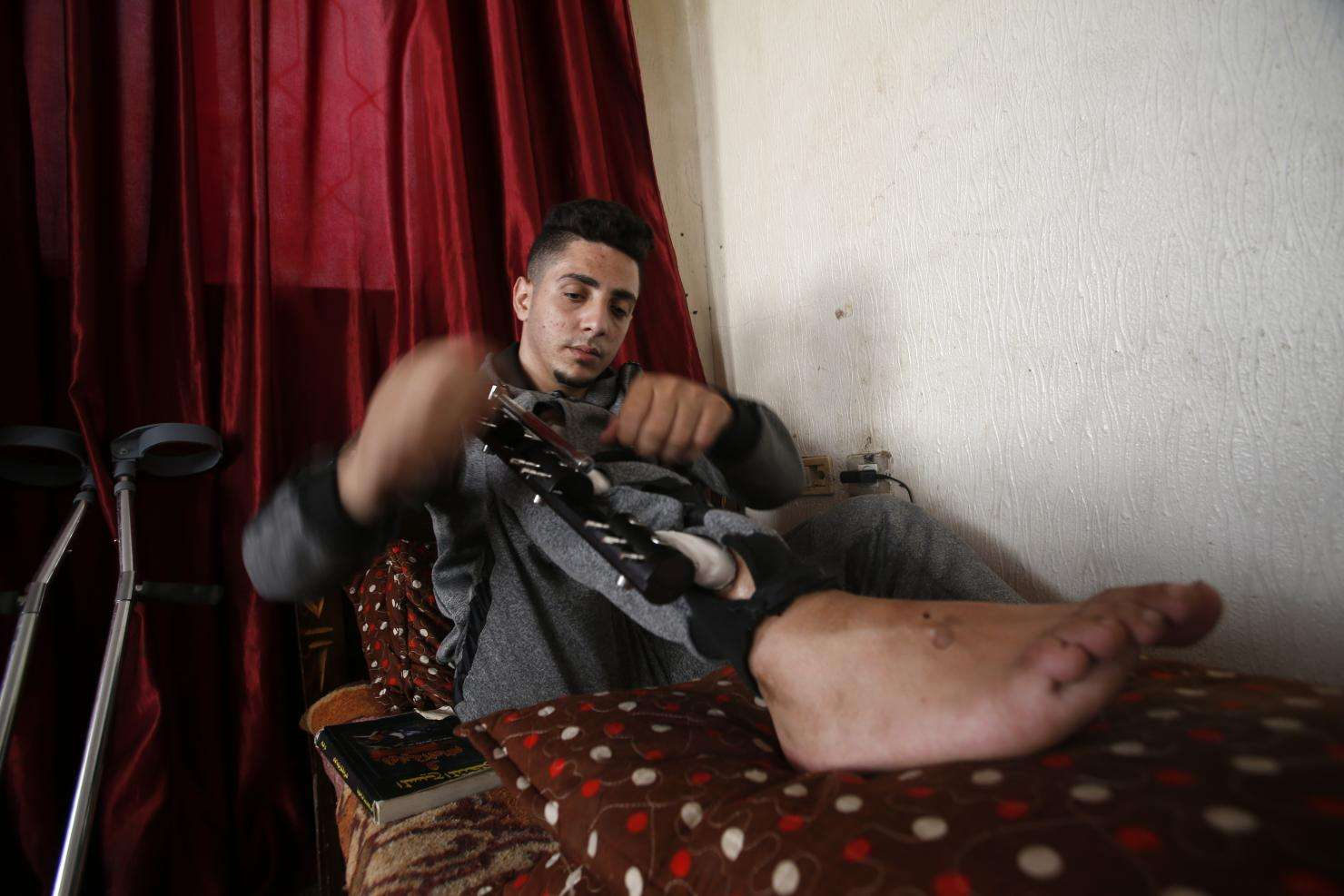 Iyad, 23, in his house in Gaza.