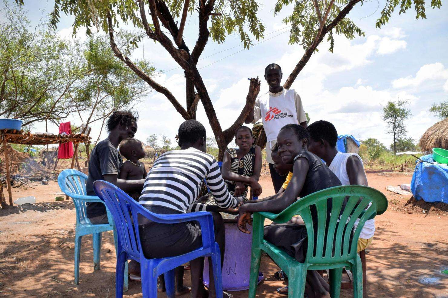 Refugees from South Sudan eat and drink in Bidi Bidi refugee camp in Northern Uganda.