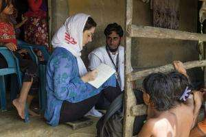 MSF humanitarian affairs staff interview a newly arrived Rohingya family