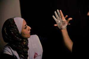 The 3D project from MSF foundation aims to evaluate new technologies to give access to specific care such as prosthetics and orthotics for neglected patient populations. Here, the project manager in Amman evaluates the first prototype of the patient's hand whose fingers are stretched. The second prototype has been designed with flexed fingers to facilitate grip with its active thumb.