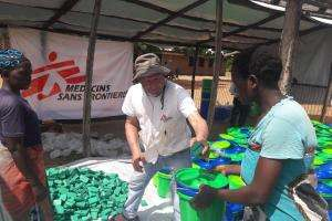 MSF emergency coordinator Said Ayub distributes non-food items including buckets and soap to people affected by the flooding in Makhanga district.