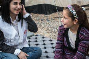 Eleven-year-old Rasha with Raz Babakr, a Médecins Sans Frontières (MSF) psychologist.