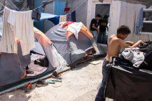 Many asylum seekers are forced to sleep in tents near the border.