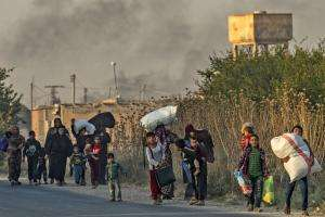 Civilians fleeing offensive in Ras al-Ain, Syria