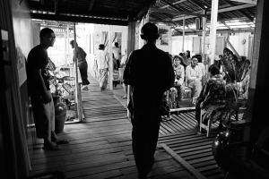 Patients wait in the reception area at MSF's clinic in Yangon