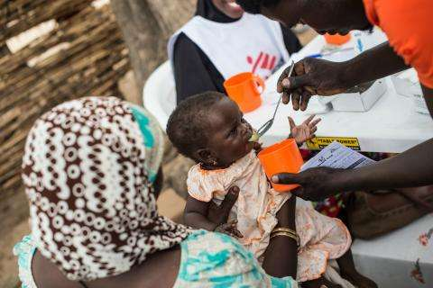 Child receives monthly dose for malaria prevention