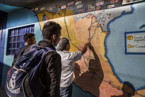 Men check a map at the La 72 migrant shelter in Tenosique, Mexico.