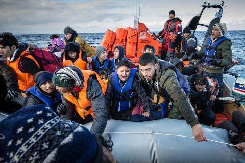 Greenpeace and MSF rescuing Afghan refugees in a sinking boat - Lesvos, Greece