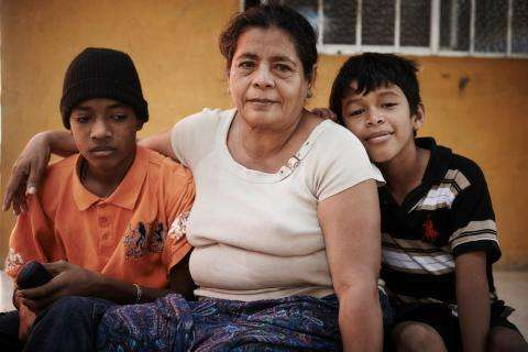 Pictured here in Mexico, 54-year-old Rosa fled gang violence in El Salvador with two of her grandchildren.