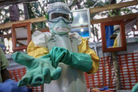 An MSF team member prepares to enter the high risk zone of the Ebola treatment center in Mangina, DRC.