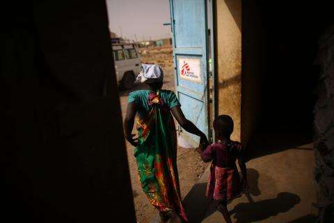 Patient leaving MSF clinic inside Bentiu town