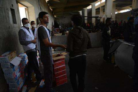 MSF teams conduct a food distribution in a detention center in Libya.